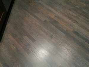 Custom grey stain with a red oak wood floor on a 45 degree angle